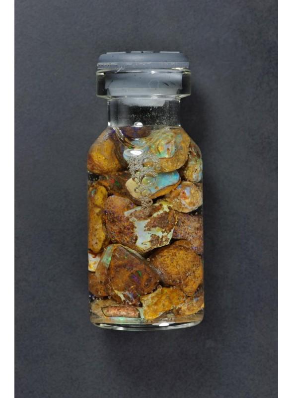 Rough opal vial